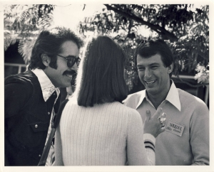 Werner Erhard talking with two people